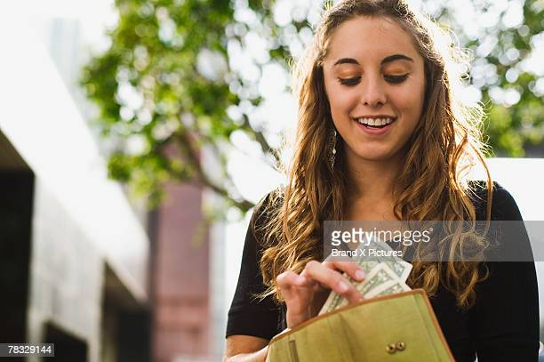 Teen removing money from wallet