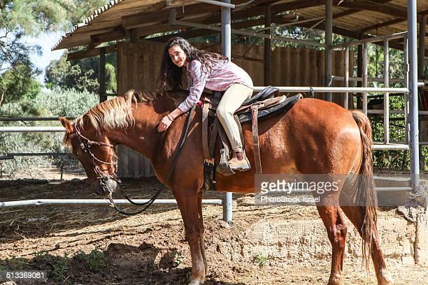Teen rides her horse