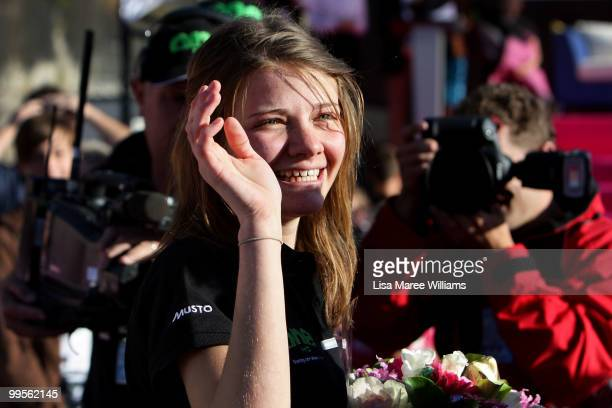 Teen sailor Jessica Watson waves to the crowd as she arrives back home in Sydney following her world record attempt to become the youngest person to...