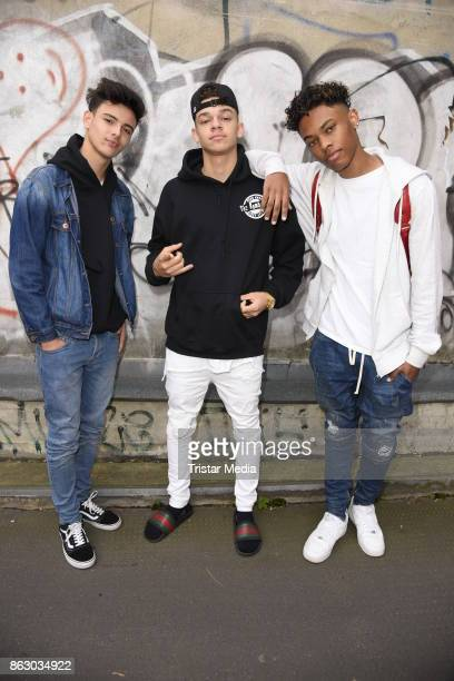 US teen stars and singer Devin Gordon Daniel Veda and Kevin Alston of the band The Bomb Digz pose for pictures before their concert on October 19...