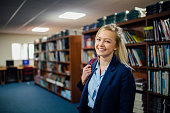Portrait of a teen student in the library of her school.