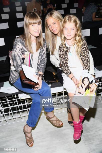 Teen Vogue Editor in Chief Amy Astley Vogue Senior Market Editor Meredith Melling Burke and Eloise Burke attend the Lacoste fashion show during...