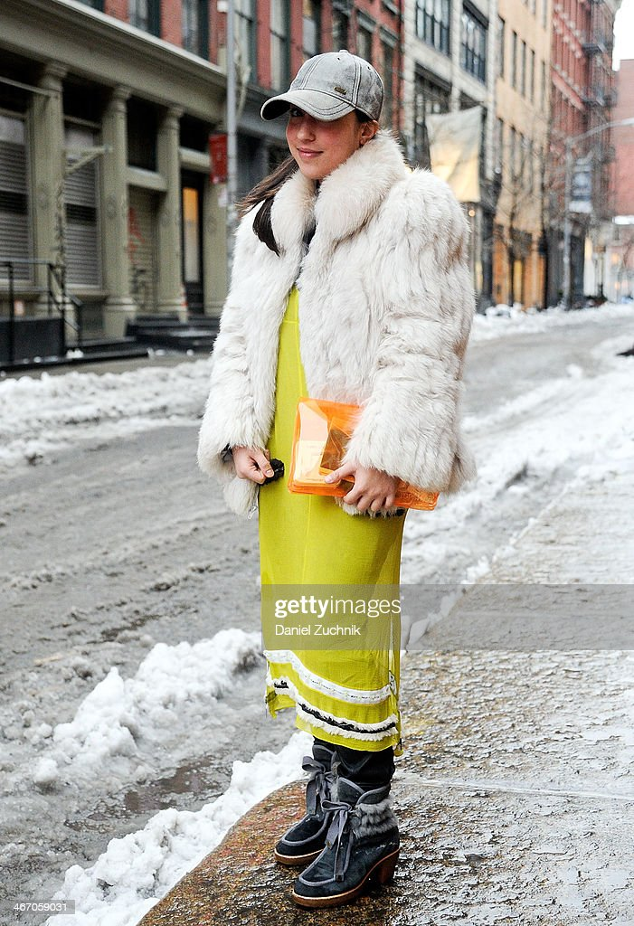 Teen Vogue fashion assistant Sarah Brody is seen outside the Pas de Calais show wearing a vintage white fur, Proenza Schouler dress, Marc by Marc Jacobs boots, Top Shop clutch and a Stefan hat on February 5, 2014 in New York City.