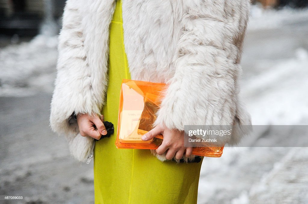 Teen Vogue fashion assistant Sarah Brody is seen outside the Pas de Calais show wearing a vintage white fur, Proenza Schouler dress and a Top Shop clutch on February 5, 2014 in New York City.