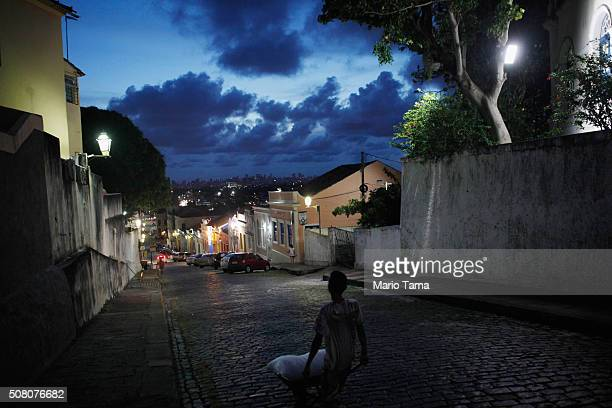 A teen walks on February 2 2016 in Olinda Pernambuco state Brazil In the last four months authorities have recorded thousands of cases in Brazil in...