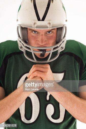 Teen wearing football gear, portrait : Stock Photo