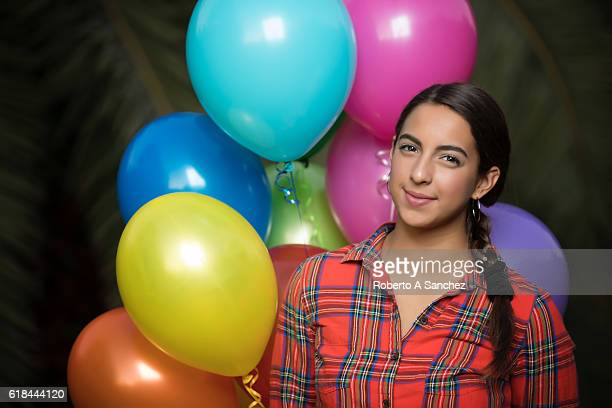 Teen with balloons