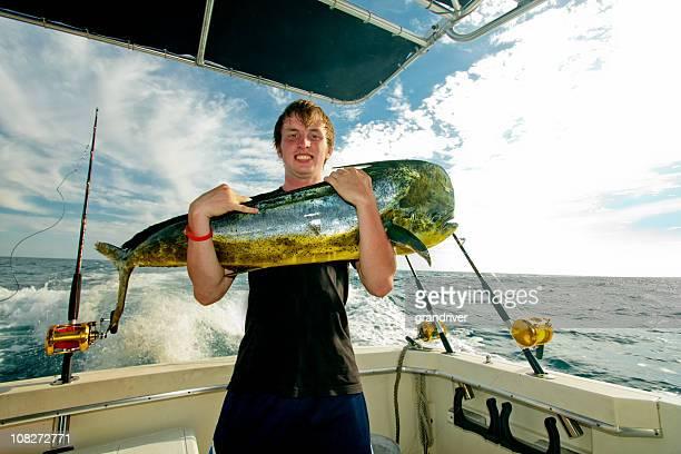 Teen with MahiMahi Dorado or Dolphin Fish on a boat
