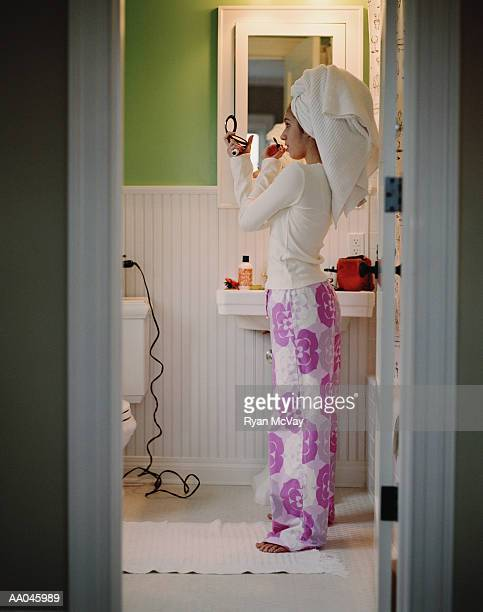 Teenage Applying Make-Up in the Bathroom