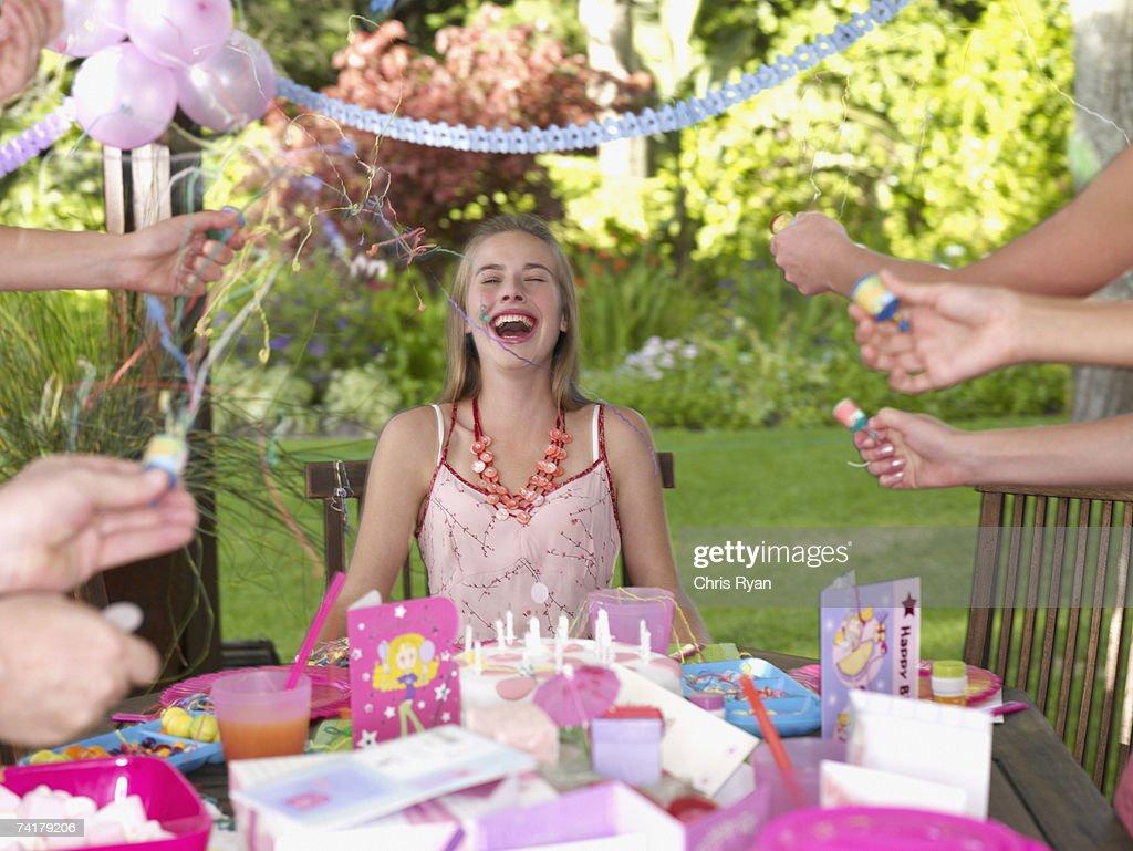 Teenage birthday girl laughing outdoors : Stock Photo
