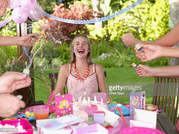 Teenage birthday girl laughing outdoors