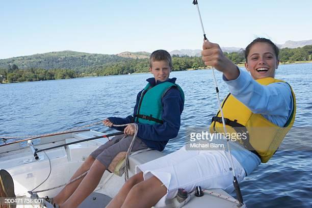 Teenage boy and girl (12-14) sailing