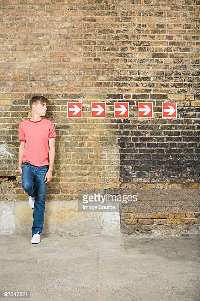 Teenage boy and row of arrows