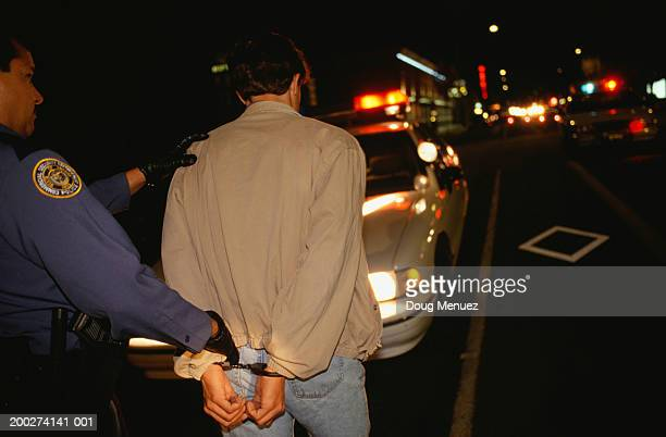 Teenage boy (16-17) being arrested