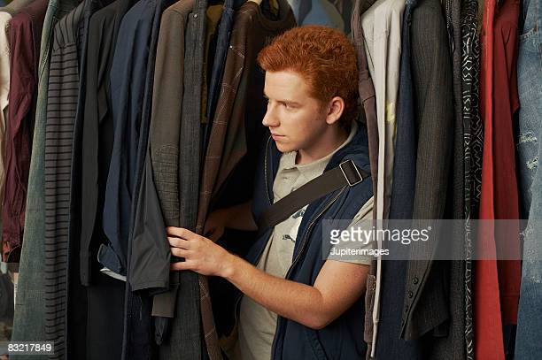 Teenage boy browsing through clothes