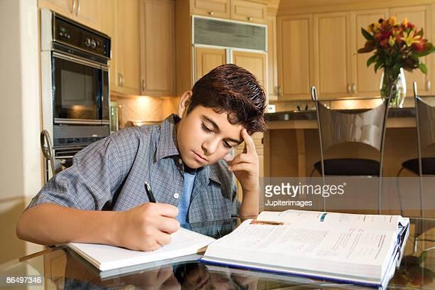 Teenage boy doing homework