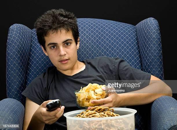Teenage boy eating junk food