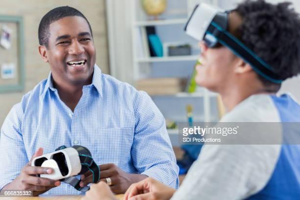 Teenage boy enjoys virtual reality goggles
