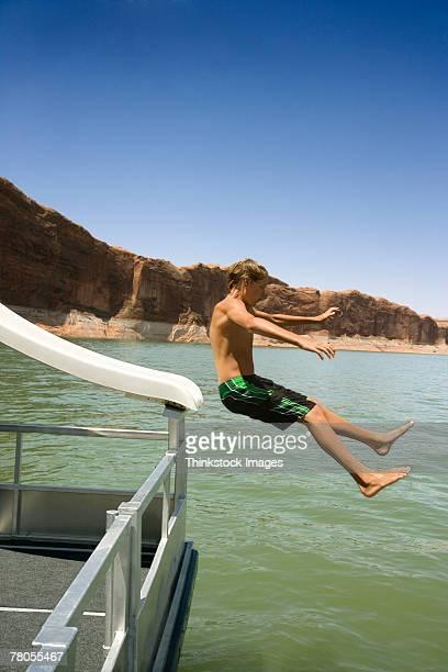 Teenage boy falling from slide into Lake Powell, Utah