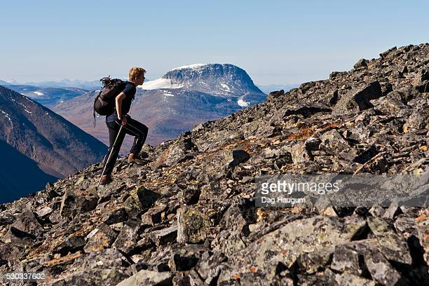 Teenage boy hiking on mountain