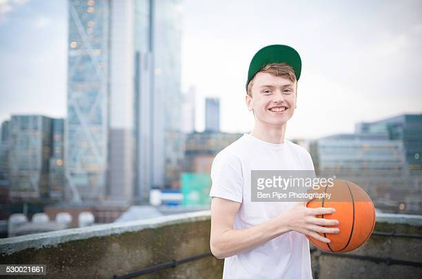 Teenage boy holding basketball