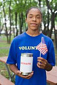 Teenage boy holding can for donations