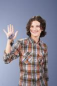 Teenage boy (13-15) holding car keys, smiling, portrait
