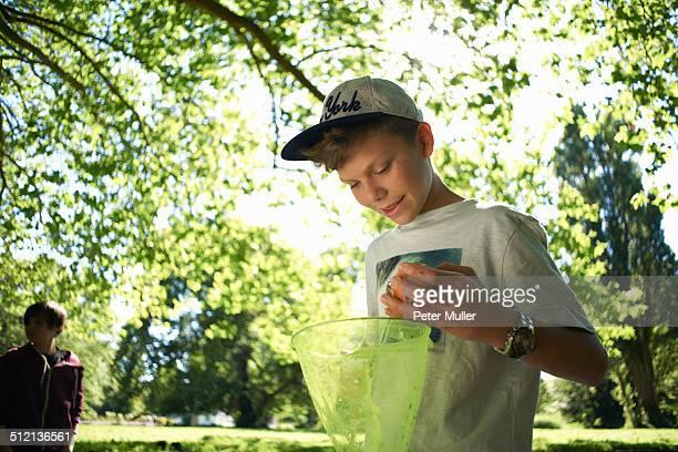 Teenage boy holding fishing net