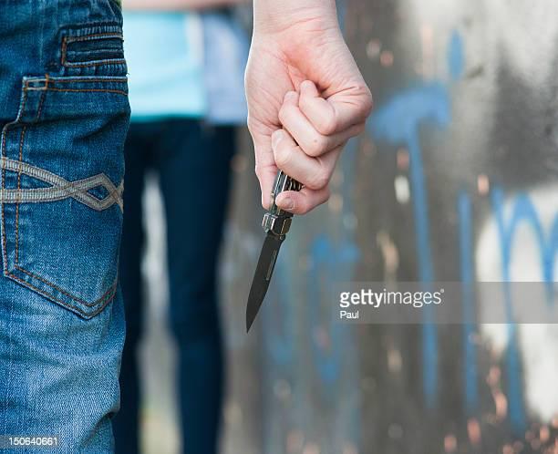Teenage boy holding knife