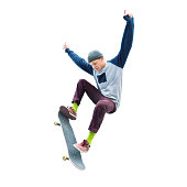 A teenage boy in a hat and a sweatshirt jumping with a skateboard does a trick on an isolated white background. The cut out character the preparation.