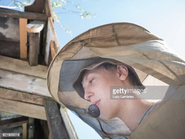 Teenage boy in beekeeper's gear