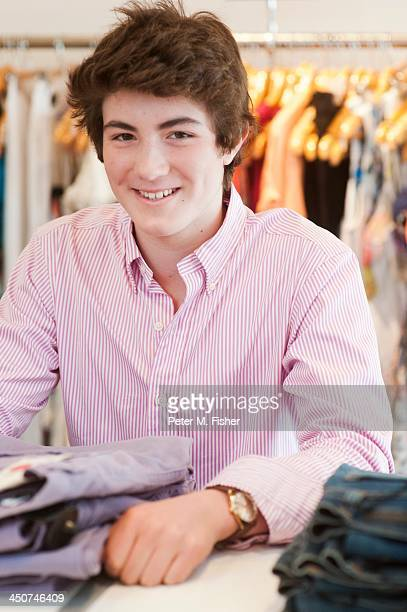 Teenage boy (16-17) in fashion boutique