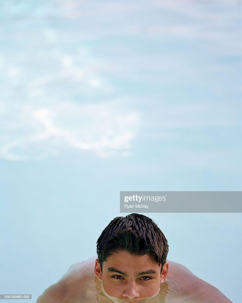 Teenage boy (13-15) in swimming pool, high section : Stock Photo