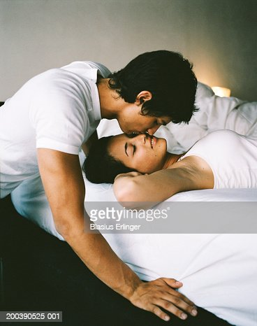 Teenage boy  16 18  kissing girl sleeping in bed   Stock Photo. Teenage Boy Kissing Girl Sleeping In Bed Stock Photo   Getty Images