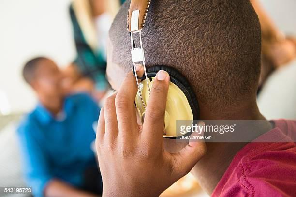 Teenage boy listening to headphones