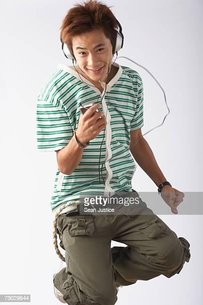 Teenage boy listening to mp3 player