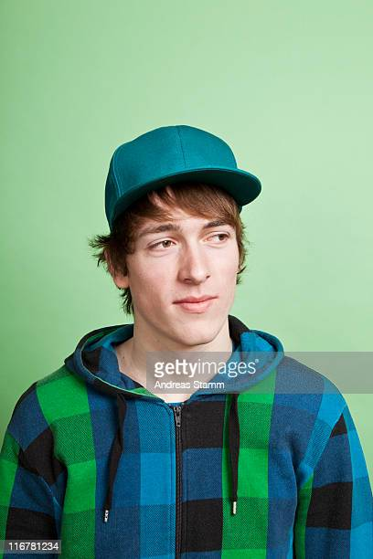 A teenage boy looking off to the side with curiosity, portrait, studio shot
