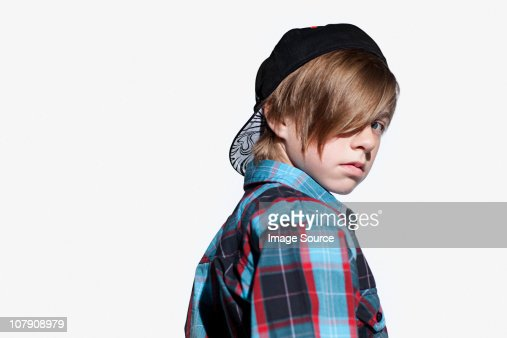 Teenage boy looking over shoulder