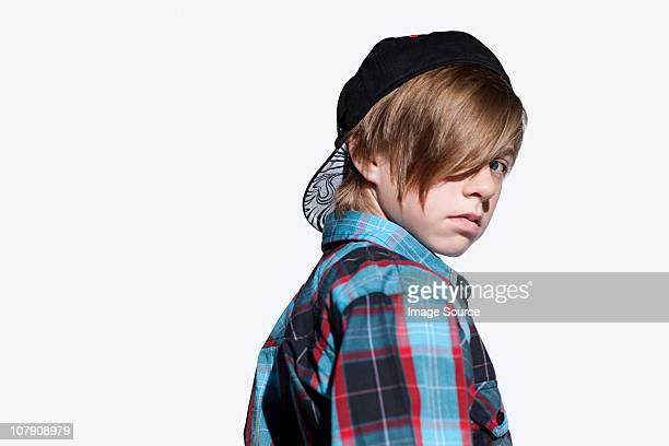 Teenage boy looking over shoulder