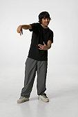 Teenage boy (16-17) making rapper gestures, portrait
