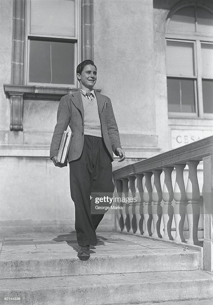 Teenage boy (14-15) on steps, (B&W) : Stock Photo