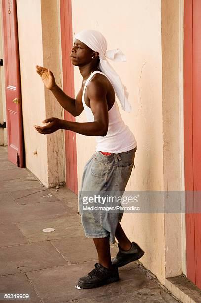 Teenage boy (16-17 years) performing in street, side view