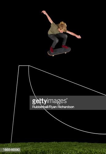 Teenage boy (14-15) performing stunt on skateboard : Stock Photo