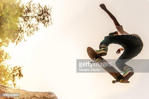 Teenage Boy Performing Stunt on Skateboard
