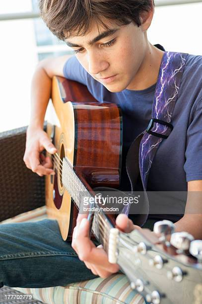 Teenage Boy playing Acoustic Guitar