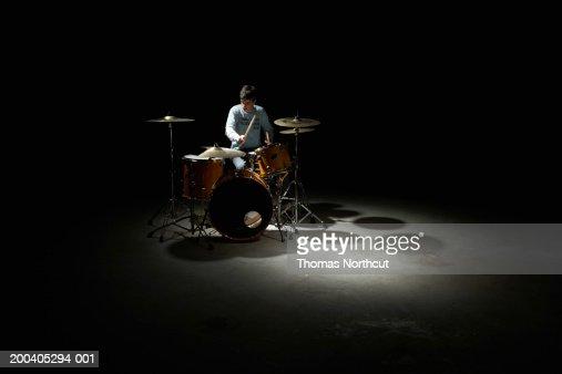 Teenage boy (13-15) playing drums