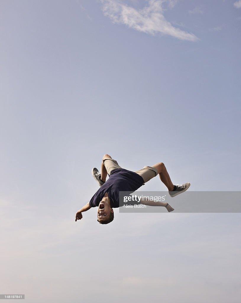 Teenage boy posing in mid-air : Stock Photo