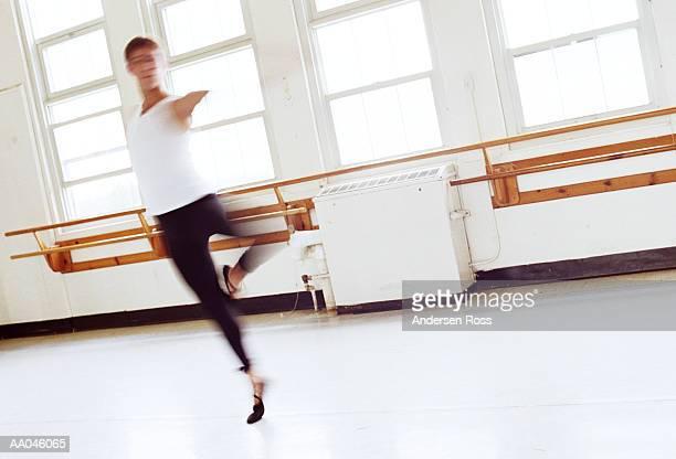 Teenage boy (15-17) practicing in ballet studio (blurred motion)
