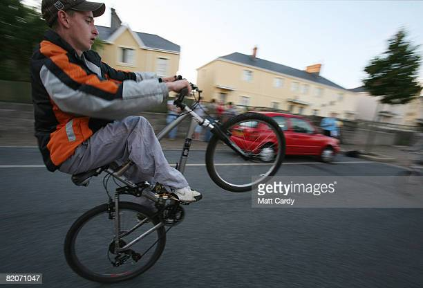 A teenage boy rides his bike on the streets of the Close Hill estate where a voluntary night curfew for all under 16yearolds has recently been...
