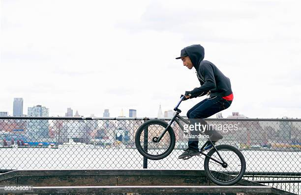 Teenage Boy riding a BMX Bike